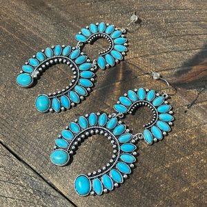 Double horseshoe turquoise earrings.